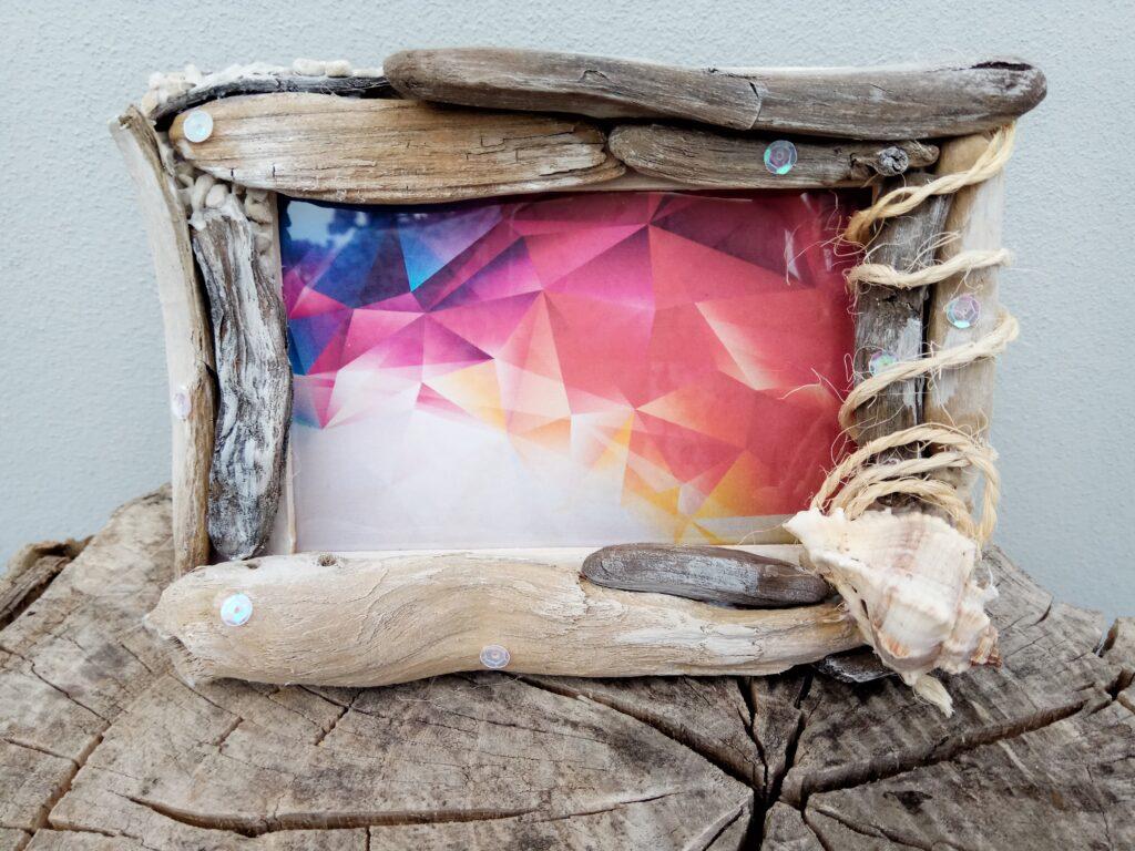 Cornice portafoto con conchiglia e legni di mare