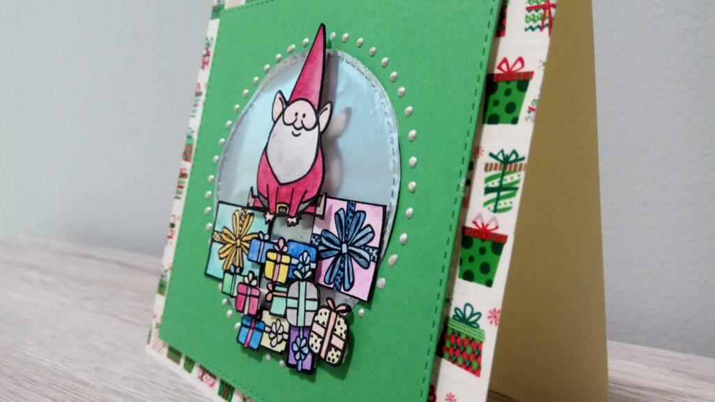 Card natalizia Babbo Natale che salta i regali