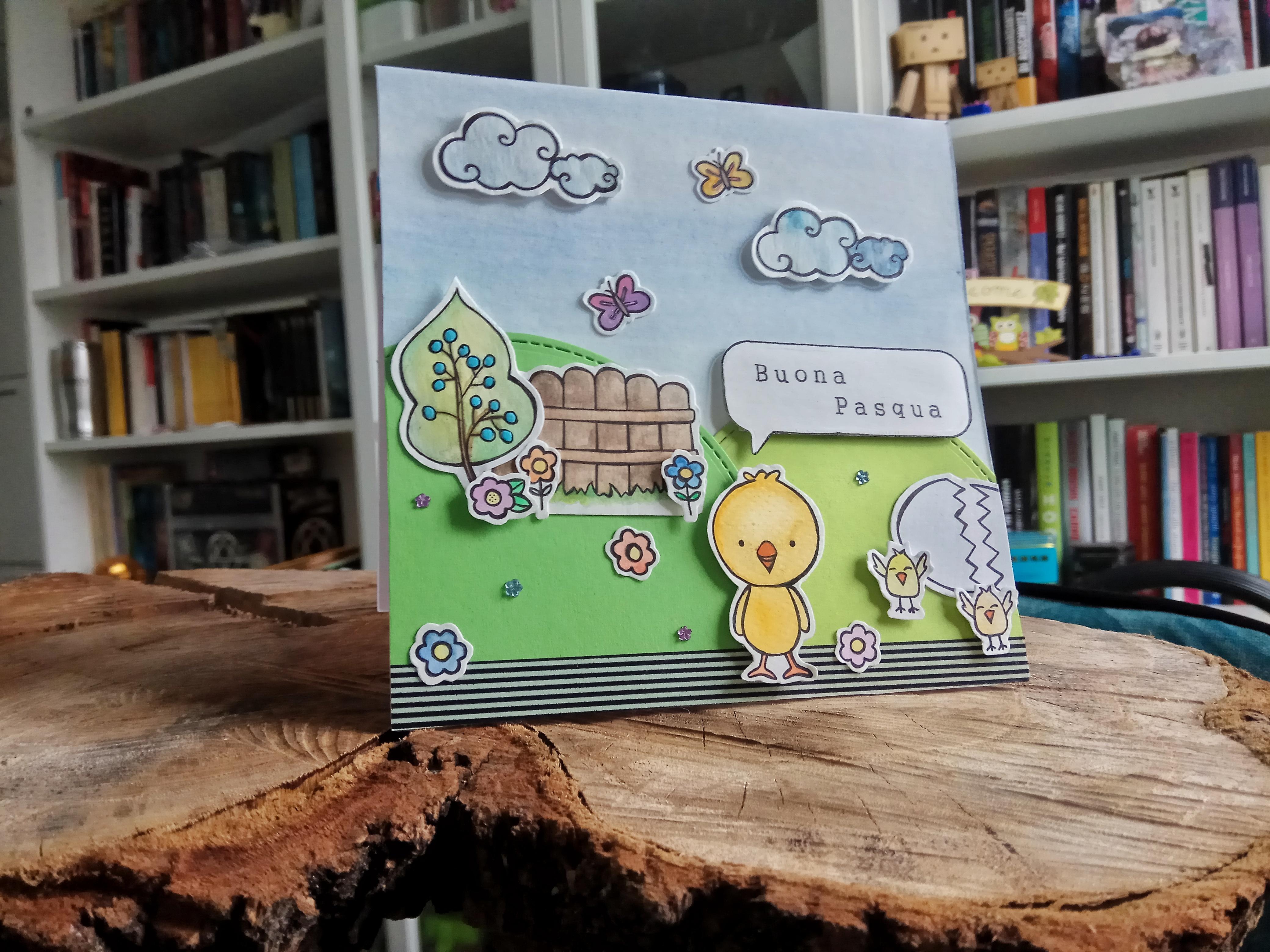 Card di Pasqua con pulcini e prato fiorito