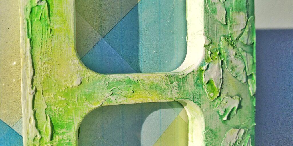 Cornice portafoto floreale a 3 scomparti sulle tinte del giallo e del verde