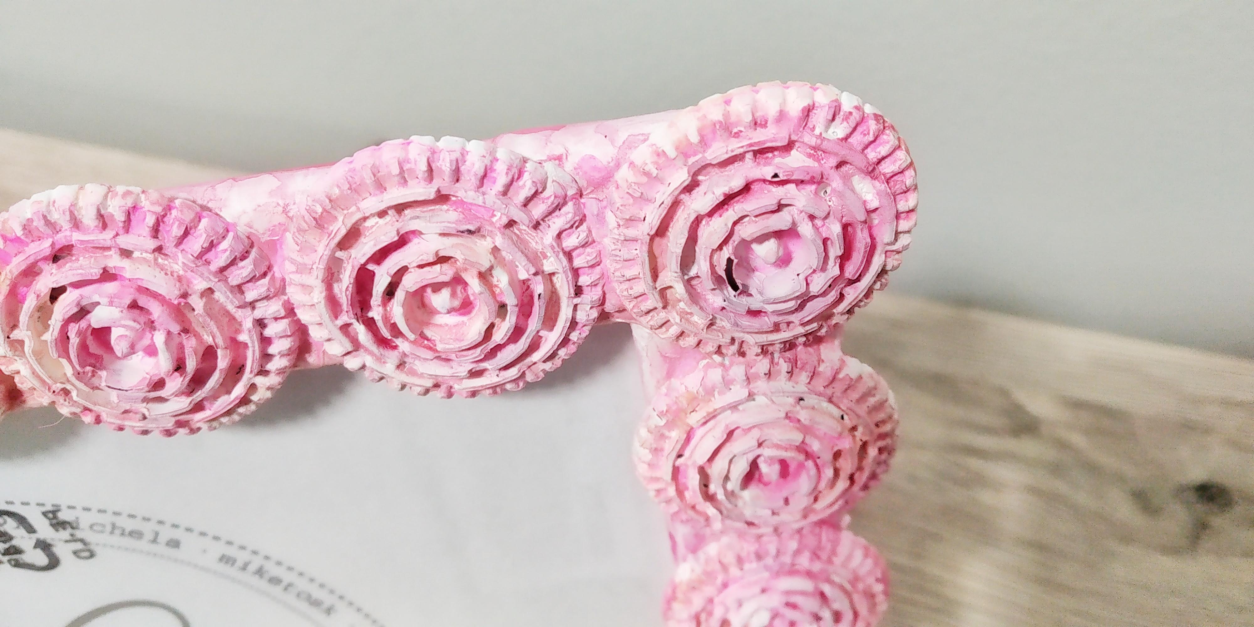 Cornice portafoto con filtri caffè sui toni del rosa
