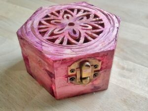 pinkish hexagonal box.